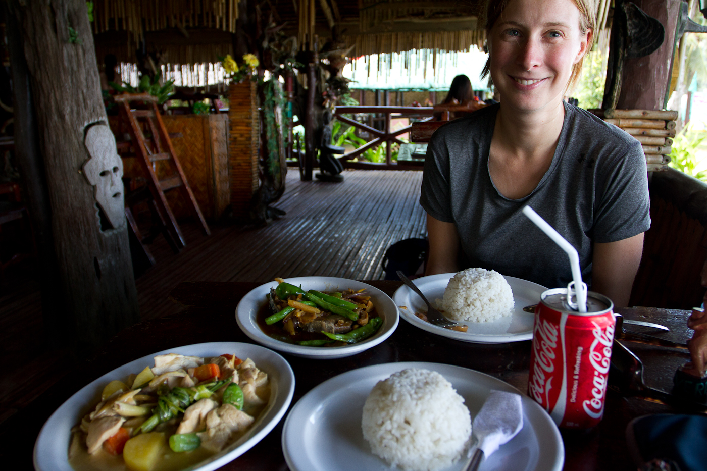 Manuela posing with our meal in Sabang on the island of Palawan