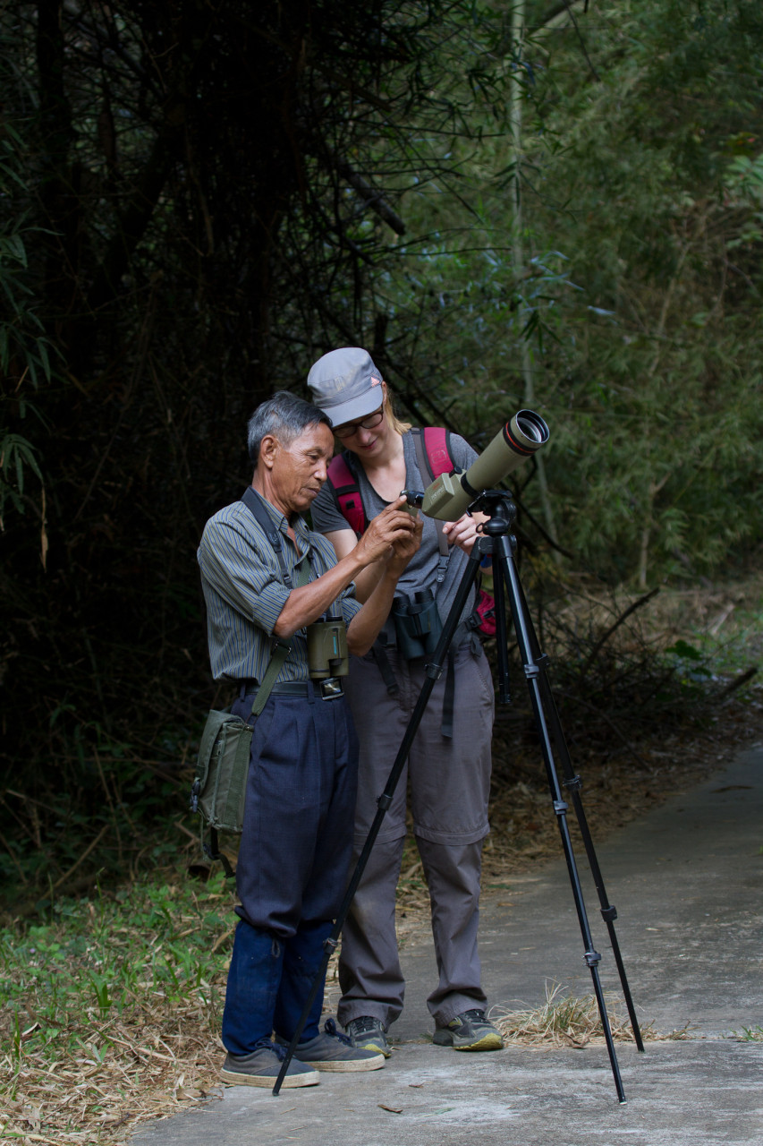 Manu learning to Digiscope with our guide Duyen at Cat Tien. Digiscoping is using the spotting scope to take pictures with a smartphone or digital camera.