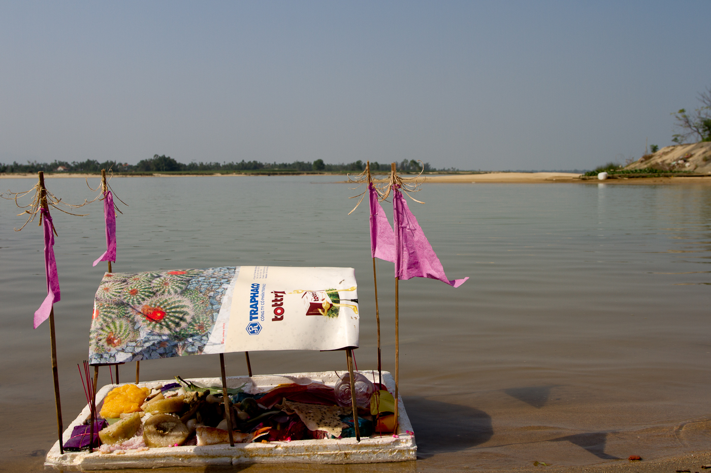This little boat carrying offerings washed up at the edge of the river's main channel