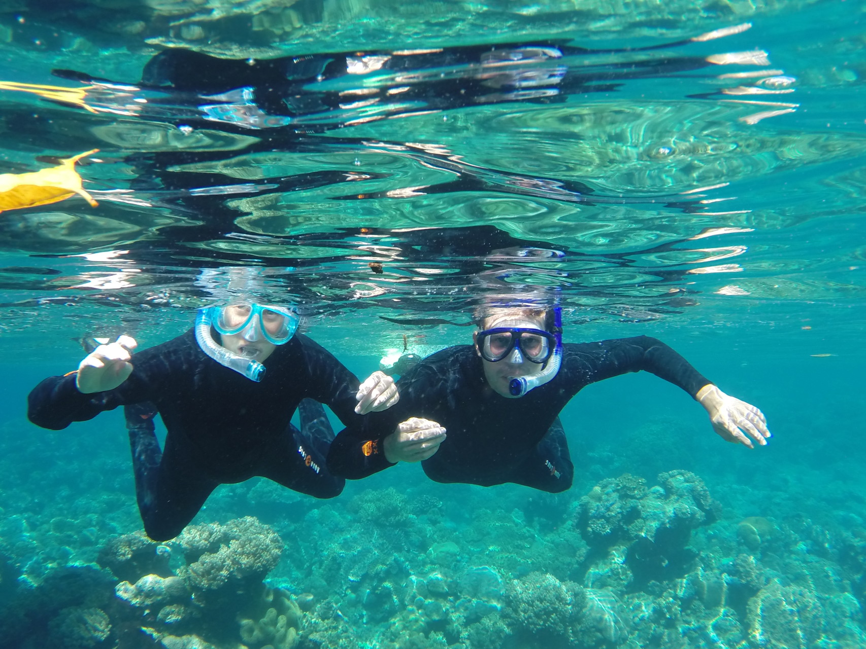 Two very happy snorkelers at Halmahera. Photo courtesy of Rients Faber.