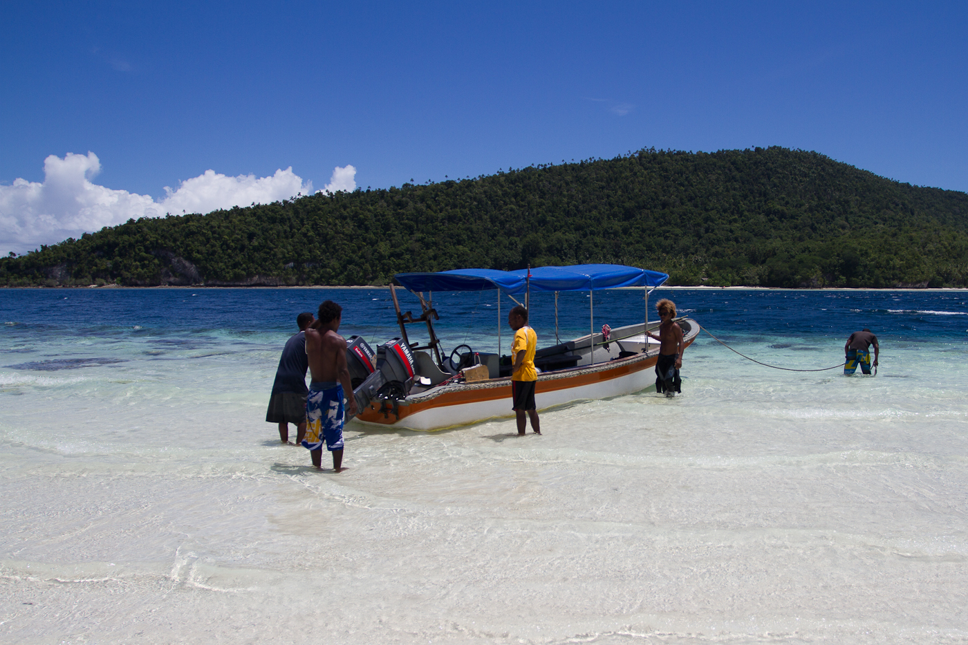 Our snorkeling boat, parked at the sandbar.