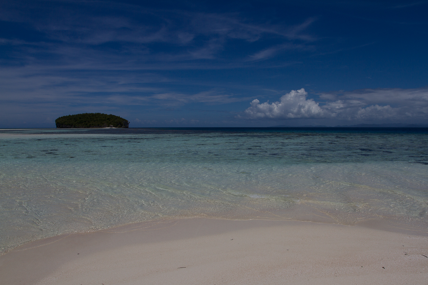 "View from a sandbar towards 'Little Kri Island,"" in Raja Ampat Islands, Papua."