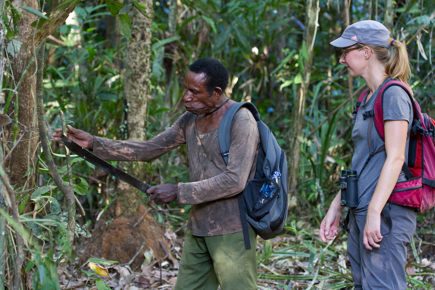 Pak Martinus teaches Manu to use a machete. Martinus could take out whole trees with that thing.