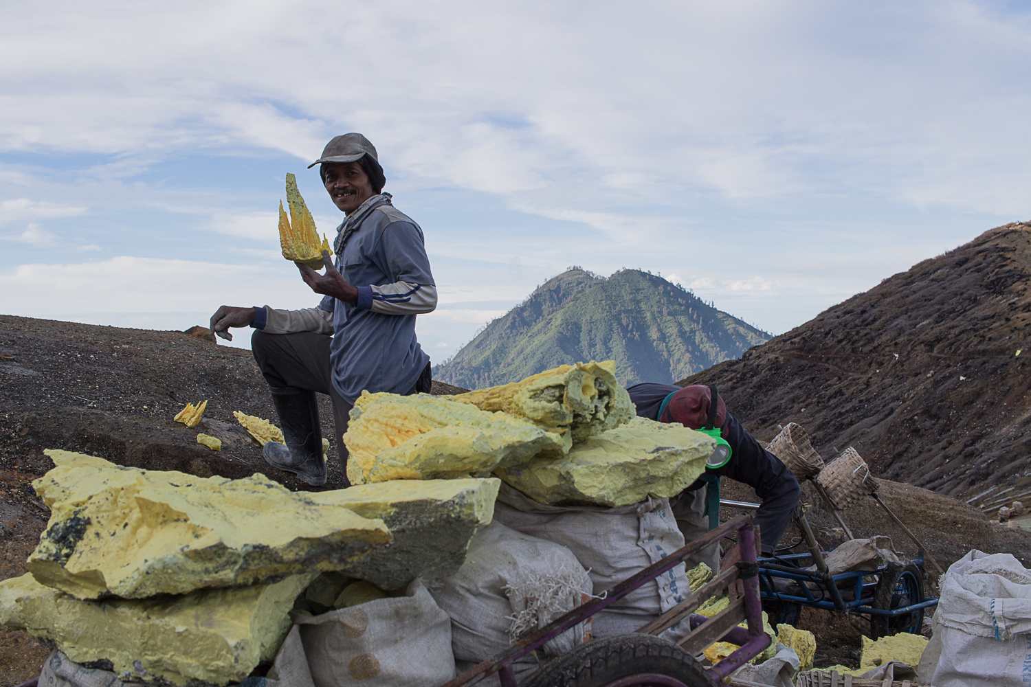 Hikers ascending Mt. Ijen share the trails with miners who enter the crater to collect sulfur.