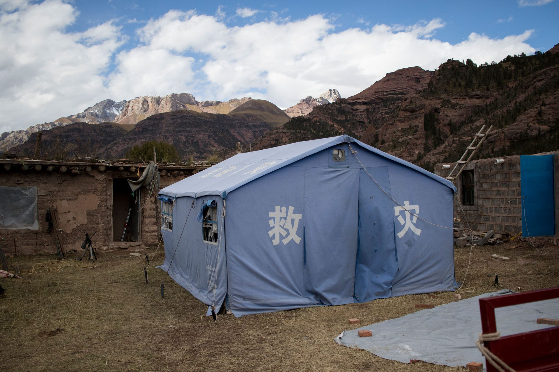 The family's son stayed in a left-over relief tent.
